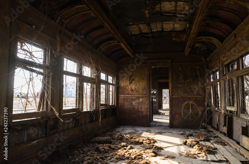 Photo  Interior of rusted vintage rail car with natural light coming through the windows
