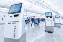 Self Service Machine And Help Desk Kiosk At Airport For Check In, Printing Boarding Pass Or Buying Ticket