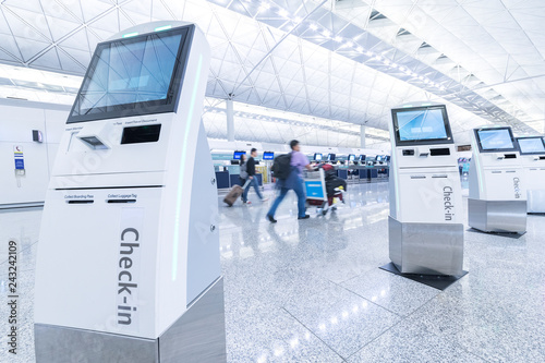 Self service machine and help desk kiosk at airport for check in, printing board Wallpaper Mural