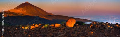 Teide volcano illuminated by the warm light of the rising sun. National Park Teide, Tenerife