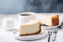 Classical New York Style Cheesecake And Coffee On Table. Side View. Coffee And Cake