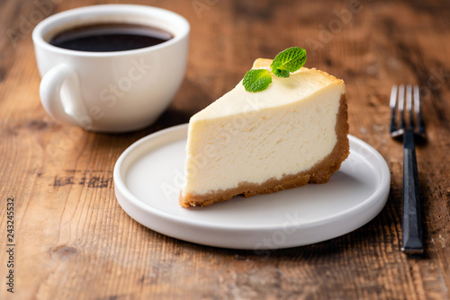 Cheesecake and cup of coffee on wooden table. Coffee and cake. Horizontal view