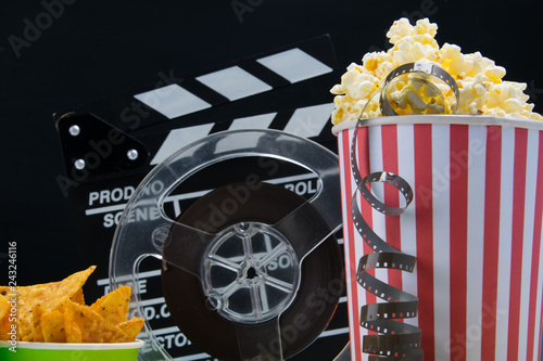 Foto op Canvas Buffet, Bar on a black background, a bucket of popcorn, a bucket of nachos, film and double for filming