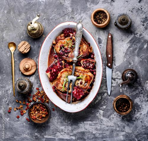 Grilled pork chop in pomegranate sauce