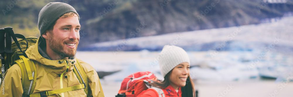 Fototapety, obrazy: Two hikers people walking together hiking in wilderness. Alpine climbers mountaineering couple trekking in ice snow mountains. Panorama banner of team hiking in winter.