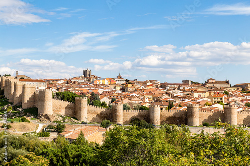Fotografiet  Panoramic view of the historic city of Avila from the Mirador of Cuatro Postes, Spain, with its famous medieval town walls