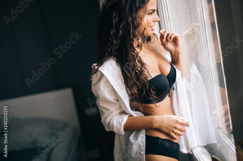 Fotografie, Obraz  Sensual woman in sexy pose with long natural hair, open shirt and black panties