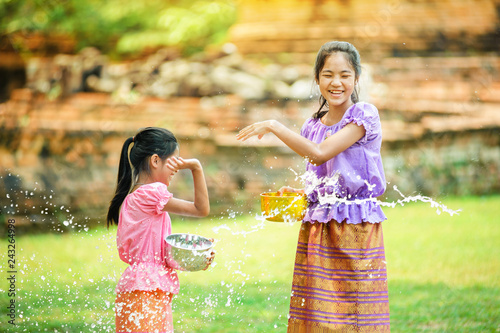 thai girls children playing water in songkran festival with thai period dress Wallpaper Mural
