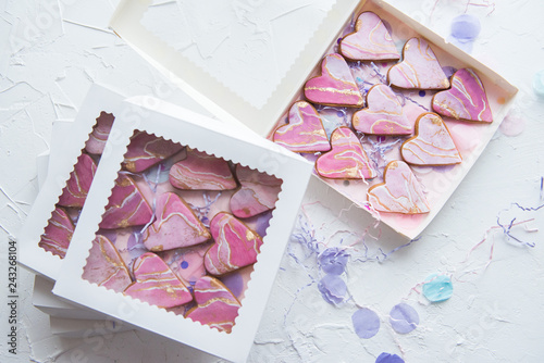 Photo  Boxes with cookies in the form of marble hearts for gifts
