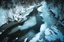 Winter Scene With A Frozen River
