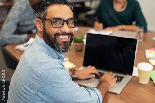 Fototapeta Latin mature businessman working on laptop obraz