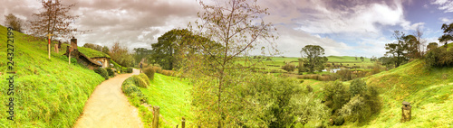 Hobbit houses in Hobbiton, New Zealand. Panoramic view of beautiful countryside in winter