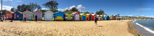 BRIGHTON BEACH, AUSTRALIA - SEPTEMBER 7, 2018: Panoramic View Of Colourful Beach Huts. They Are A Famous Attraction For Tourists