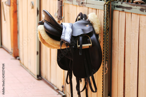 Valokuvatapetti Photo of a beautiful leather sport saddle on equestrian competition