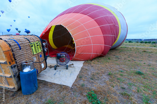 The process of inflating balloons with a gasoline fan and a gas burner.