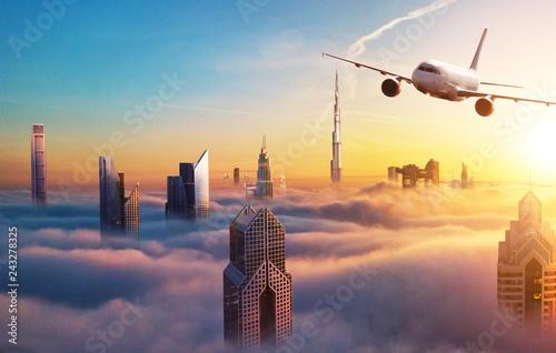Keuken foto achterwand Stad gebouw Commercial jet plane flying above Dubai city
