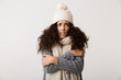 Leinwanddruck Bild - Upset young woman wearing winter scarf