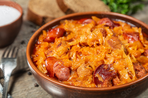 Braised cabbage with meat and smoked sausage. Traditional Polish and Lithuanian dishes.