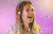 canvas print picture - Carnaval Brazil. Throwing confetti. Face of young woman with colorful makeup, dressed up for fun. Bright background. Party concept, celebration and festival.