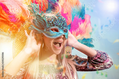 Staande foto Carnaval Beautiful young woman in carnival mask. Beauty model woman wearing masquerade mask at party over holiday background with magic glow. Christmas and New Year celebration. Glamour lady with perfect make