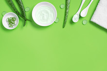 Background With Natural Cosmetics Of Aloe Vera Juice, Fresh Leaves Of Aloe