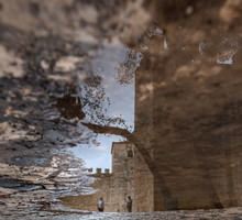 Sao Jorge Castle In Lisbon, Puddle Reflection