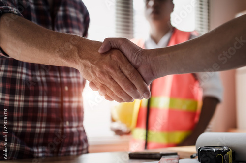 Fényképezés  team of construction worker shaking hands with customer after finishing up busin
