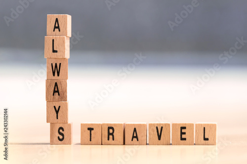 wood cubes with the words always travel Wallpaper Mural