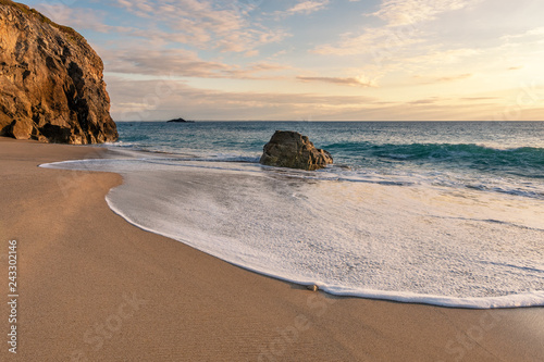 French landscape - Bretagne. A beautiful beach with wild cliffs in the background at sunset. - 243302146