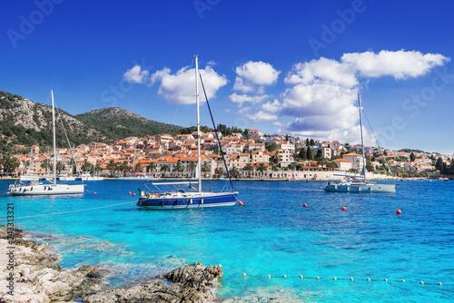 Foto auf AluDibond Dunkelblau Sailing boats in a beautiful bay of the Hvar island, Dalmatia, Croatia