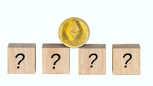 Ethereum  Coin  And Box Wood Have Space For Input Text Are Placed Together On A  Floor, Concept Hard Fork And New Coin Distribution For Coin Holders ETH