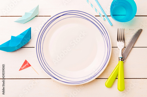 Table setting for kids - empty plate with decorations around