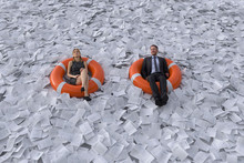 Two People Are Floating On The Sea Of Paper