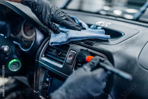 Auto detailing of car interior on carwash service