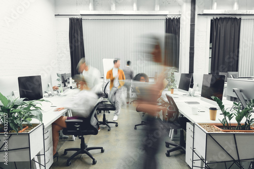 Obraz contemporary open space office interior with blurred coworkers in motion - fototapety do salonu