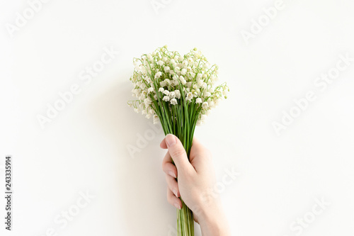 Wall Murals Lily of the valley Woman hold in hand bouquet of lilies of the valley