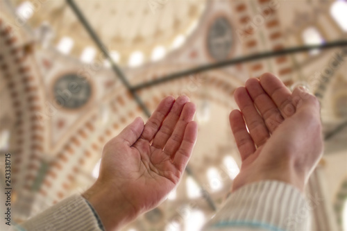 Muslim man praying inside the mosque Canvas Print