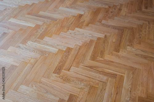 Obraz parquet floor background - heringbone parquet flooring - fototapety do salonu