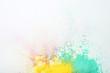 Colorful holi powders on white background