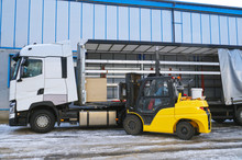 Unloading Goods From A Truck With A Forklift. Transport.