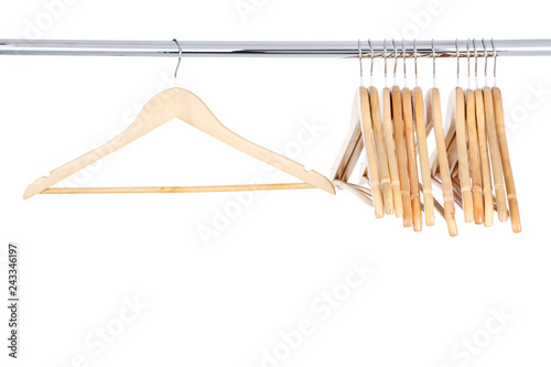 Valokuvatapetti Wooden hangers hanging on white background