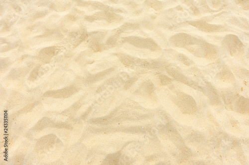 Photo Stands Stones in Sand Fine beach sand in the summer sun