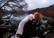 Beautiful Sleeping Beauty With Long Red Hair And A Rock For A Bed