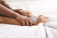 Black Couple Hands Pulling White Sheets In Ecstasy