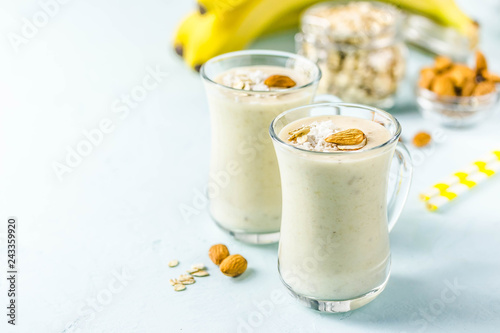 Vanilla cinnamon almond smoothie with coconut flakes. Selective focus, space for text.