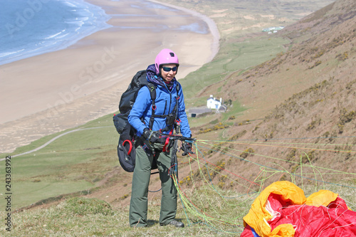 Paraglider launching at Rhossili