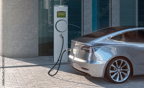 Leinwand Poster Charging an EV electric sedan car with silver paint in a city parking lot 3d ill
