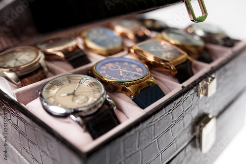 Fotografering  storage box with collection of men wrist watches