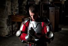 Knight Kneeling On His Knees W...