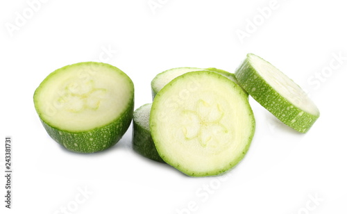 fresh green zucchini with slice isolated on white background